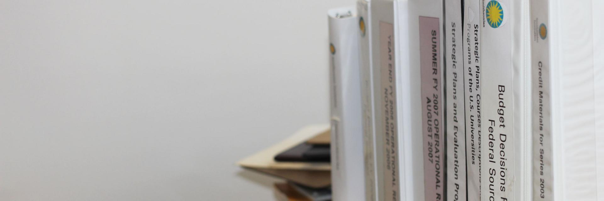 A shelf full of SOAR reports.