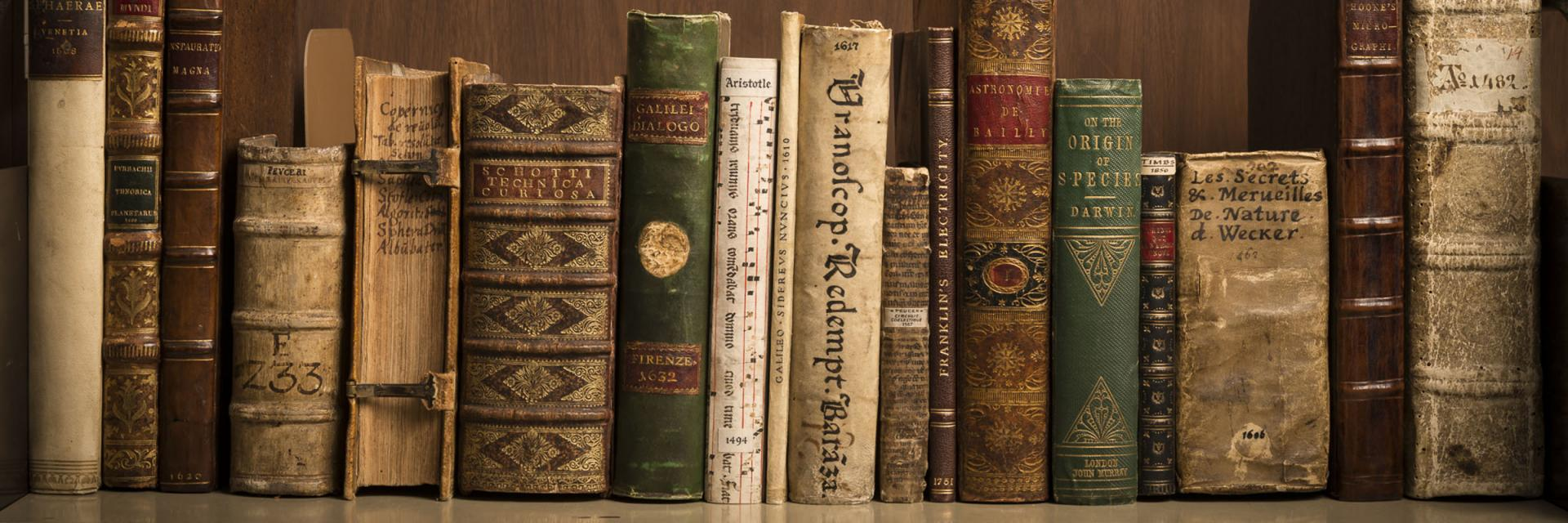 A library shelf full of old books.